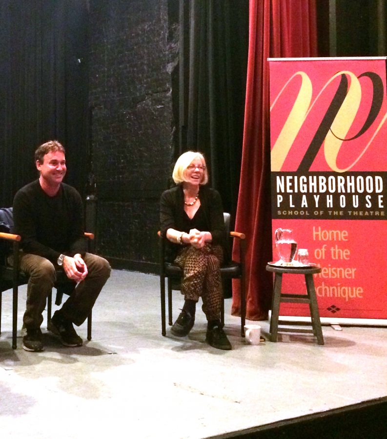 Photo of Guest Artist Speaker, Steven Rogers,  on the stage with Executive Director Pamela Moller Kareman.