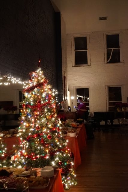 Photo of decorations, food, and drink spreads inside the Martha Graham Dance Studio for the 2016 Holiday Party.