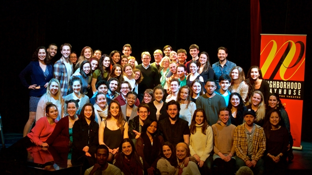 Group photo of Neighborhood Playhouse students, faculty, and staff with Matthew Broderick on the auditorium stage.