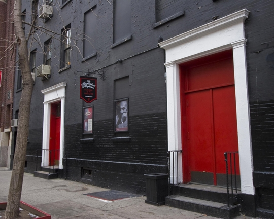 Photo of the iconic red doors of The Neighborhood Playhouse at 340 East 54th Street, New York.