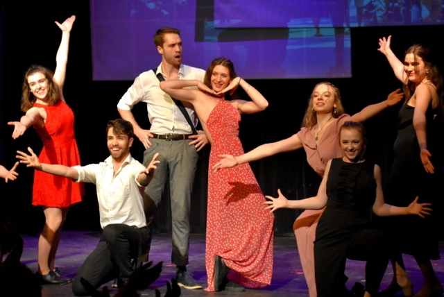 Production photo from Six Degrees of Sondheim. Seven cast members make a final pose.