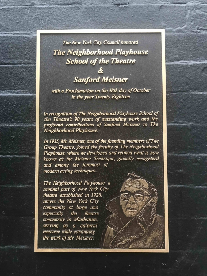Bronze plaque honoring the Neighborhood Playhouse by the New York City Council. The plaque reads: The New York City Council honored The Neighborhood Playhouse School of the Theatre and Sanford Meisner with a proclamation on the 18th day of October in the year Twenty Eighteen. In recognition of The Neighborhood Playhouse School of the Theatre's ninety years of outstanding work and the profound contributions of Sanford Meisner to The Neighborhood Playhouse. In nineteen thirty five Mr. Meisner, one of the founding members of The Group Theatre, joined the faculty of The Neighborhood Playhouse, where he developed and refined what is now known as the Meisner Technique, globally recognized and among the foremost of modern acting techniques. The Neighborhood Playhouse, a seminal part of New York City theatre established in nineteen twenty eight, serves the New York City community at large and especially the theatre community in Manhattan, serving as a cultural resource while continuing the work of Mr. Meisner.