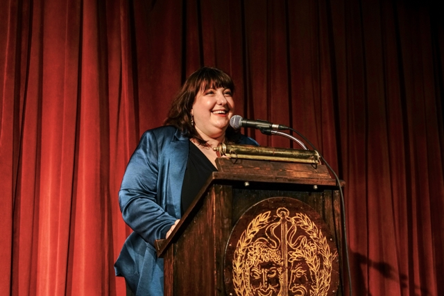 Photo of Graduation Speaker Ashlie Atkinson, standing at the podium and addressing the Class of 2019.